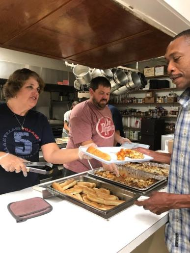 ACT Small group serving dinner at Good News Mission